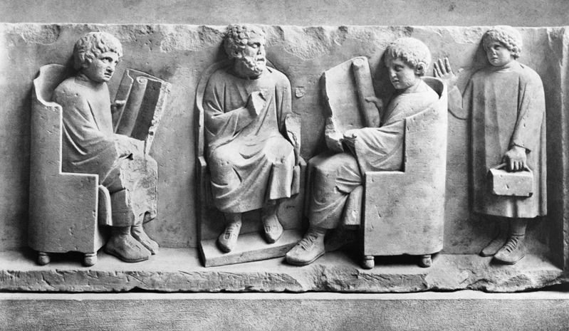 A Roman teacher and his three pupils. The child on the right seems to have brought a little Roman lunchbox with him.