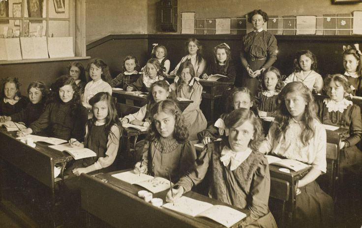 A Victorian classroom. Cheery bunch aren't they?